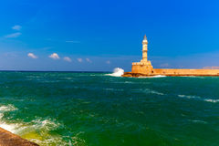 Lighthouse in old harbour, Chania, Crete, Greece Stock Photos
