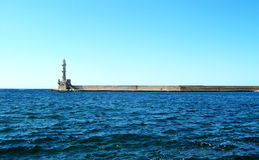 Lighthouse in Old Port of Chania in Creta Island, Greece. Side view of the lighthouse in the Old port of Chania in Creta Island, Greece. Picture taken on july 27 stock image