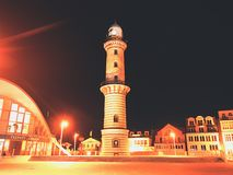 Lighthouse in old town centre Stock Photos