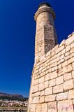 Lighthouse in the old venetian harbor at morning, city of Rethymno, Crete Royalty Free Stock Images