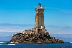 Lighthouse in open sea Stock Photos