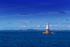 Lighthouse at Open Sea Stock Image