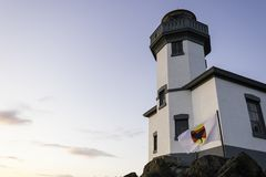 Lime Kiln Lighthouse with the orca whale warning flag in San Juan Islands stock photography