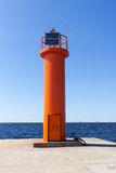 Lighthouse over blue sky and watter on the Baltic  Royalty Free Stock Photography