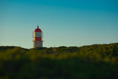 Lighthouse over green Royalty Free Stock Photos