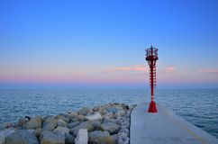 Lighthouse over the pier Royalty Free Stock Photos