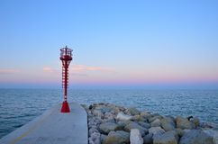 Lighthouse over the pier Stock Photography