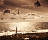 Lighthouse over sunset Royalty Free Stock Photos