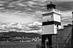 Lighthouse overlooking bay in black and white Stock Photos