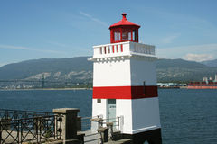 Lighthouse overlooking North Vancouver. A lighthouse is located in Stanley park which overlooks North Vancouver stock photo