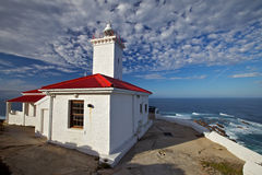 Lighthouse overlooking the seashore Royalty Free Stock Photo