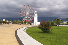 Lighthouse and overview wheel in Batumi Stock Images
