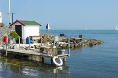 Lighthouse Paard van Marken nel pomeriggio, l'Olanda Settentrionale Immagine Stock
