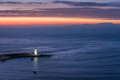 Lighthouse on the Pacific coast of Miraflores at night in Lima, Stock Photo