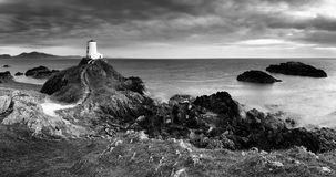 Lighthouse Panorama, Ynys Llanddwyn, Anglesey. Sping eveing on at the tip of Ynys Llanddwyn (also known as Lovers Island), a tidal island just of the coast of Royalty Free Stock Images