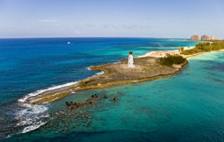 Lighthouse at Paradise Island. A lighthouse at Paradise Island in the Bahamas with Atlantis in the background Royalty Free Stock Image