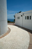 Lighthouse Path. A close up of a path around Gibbs Hill Lighthouse, Bermuda, set against a blue sky Stock Image