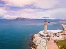 Lighthouse in Patras. Aerial drone photo of famous town and port of Patras, Peloponnese, Greece royalty free stock images