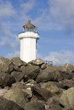Lighthouse Peaks Above Rocks Stock Photography