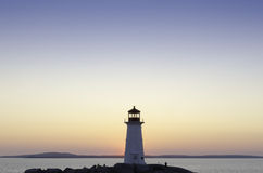 Lighthouse at Peggy's Cove, Nova Scotia at sunset Stock Photo