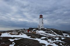 Lighthouse of Peggy`s Cove at winter time Royalty Free Stock Photography