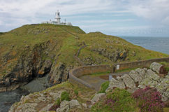Lighthouse on the Pembrokeshire Coast, St Davids Bay. Royalty Free Stock Images