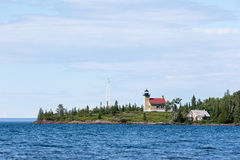 Lighthouse on a Peninsula in Lake Superior Royalty Free Stock Photography
