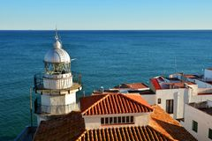 Lighthouse of Peniscola seen from Papa Luna Castle with Mediterranean Sea as Background stock photos