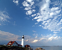 Lighthouse on a perfect day. This ia a picture of the Portland Headlight and house in Portland, Maine Royalty Free Stock Image