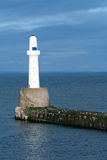 Lighthouse and pier Stock Image
