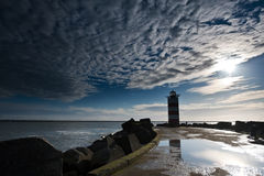 Lighthouse on pier Stock Image