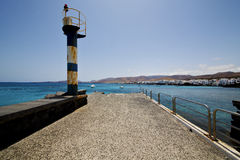 Lighthouse and pier boat in the blue sky   arrecife teguise Stock Photography