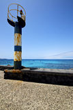 Lighthouse and pier boat in the lanzarote spain Stock Photo