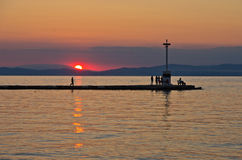 Lighthouse and pier in Limenas harbour at sunset, island of Thassos Stock Photo