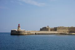 Lighthouse on the pier on Malta. Lighthouse on Malta with pier Royalty Free Stock Image