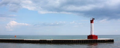 Lighthouse Pier Panoramic. Panoramic view of the lighthouse pier at the Oakville Ontario harbour on Lake Ontario in Canada Stock Photography