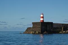A lighthouse on a pier in Ponta Delgada Royalty Free Stock Photo