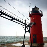 Lighthouse. Pier sailboat water lake Royalty Free Stock Photography