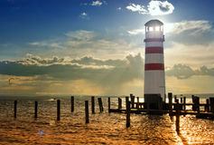 Lighthouse on the pier at sunset Royalty Free Stock Images