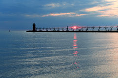 Lighthouse and Pier at Sunset Royalty Free Stock Photos