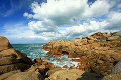 The lighthouse in the Pink granite coast Royalty Free Stock Image