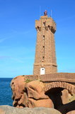 The lighthouse of Ploumanach,  Brittany, France. The lighthouse of Ploumanac'h, Cote de granit rose  in North Brittany, France Royalty Free Stock Image