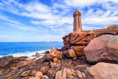 Lighthouse of Ploumanach on Cote de Granit Rose, Brittany, Franc. Lighthouse of Ploumanach Mean Ruz in Perros-Guirec on Pink Granite Coast, Brittany, France Royalty Free Stock Images