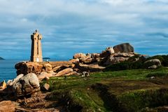 The lighthouse at Ploumanach on the Cote de Granite Rose. In the Cotes-d Armor, Brittany, France Royalty Free Stock Photo