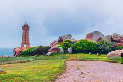 Lighthouse of Ploumanach Mean Ruz in Perros-Guirec on Pink Granite Coast, Brittany (Bretagne), France. Lighthouse of Ploumanach Mean Ruz in Perros-Guirec on Pink royalty free stock image