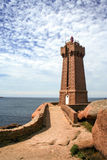 Lighthouse  at Ploumanach, on the  pink granite coast, Brittany, France Stock Photos