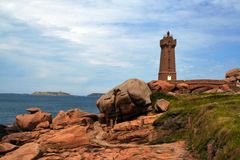 Lighthouse  at Ploumanach, on the  pink granite coast, Brittany, France Royalty Free Stock Photo