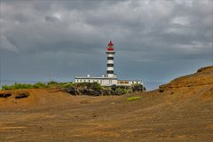 Lighthouse of Ponta da Barca. The lighthouse of Ponta da Barca started operating on February 1, 1930 and is located in Ponta da Barca north-west of Ilha Graciosa royalty free stock photo