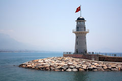 Lighthouse in port. Royalty Free Stock Photography