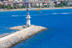 Lighthouse in port of the city of Alania Stock Image
